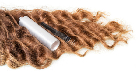 hairdressing accessories: Wavy hair and hairdressing accessories isolated on white background.