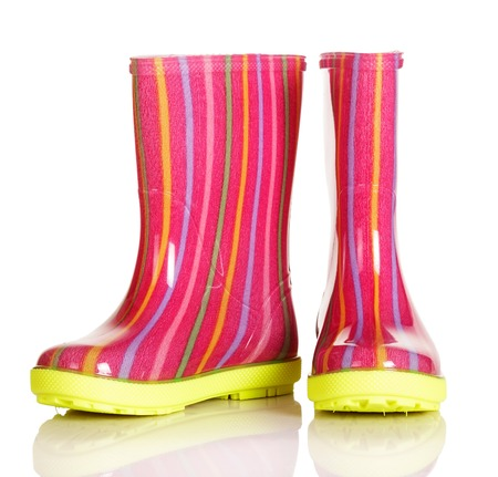 Children rubber boots for the walk in the rain and after isolated on a white background. Stock Photo