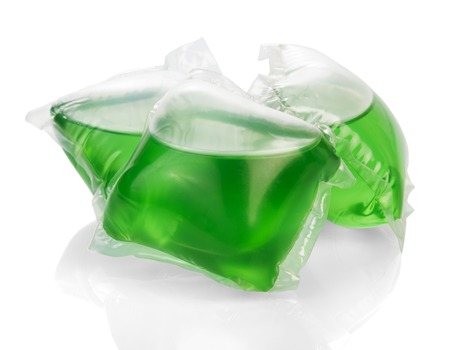 gel capsule: Green gel for washing capsules isolated on white background.