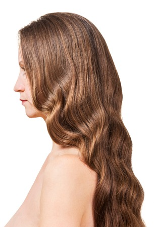 groomed: A woman with wavy brown hair isolated on white background.