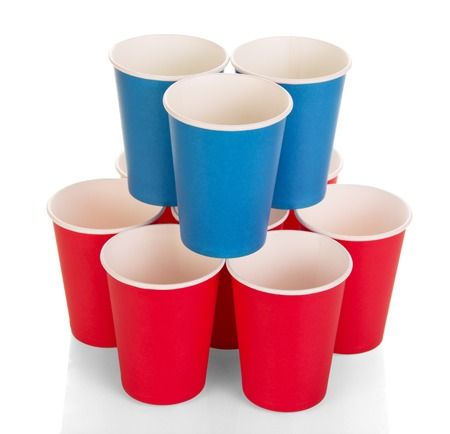 Bright disposable paper cups isolated on white background. Stock Photo