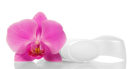Open dry deodorant for underarms and orchid flower isolated on white background.