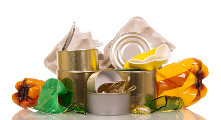 Household waste: plastic, glass bottles, cans and cardboard isolated on white background.