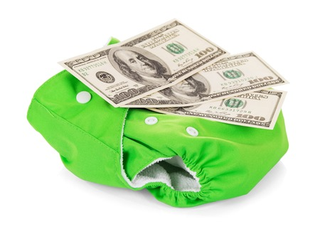 Modern eco-friendly diaper and money isolated on white background.