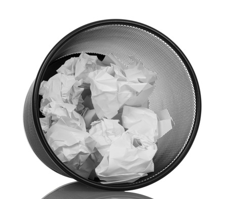 disposed: Waste basket with a crumpled paper isolated on white background.