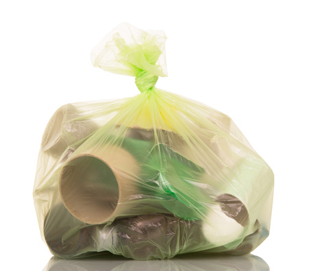 garbage bag: Full garbage bag with household waste isolated on white background.