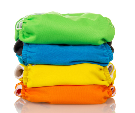 Stack environmentally friendly diapers isolated on white background.