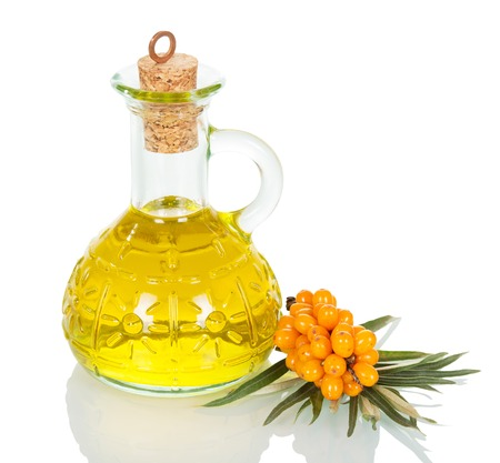 argousier: Decanter buckthorn oil isolated on white background. Banque d'images