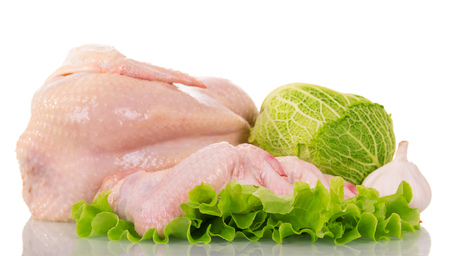 whole chicken: Raw whole chicken, lettuce and cabbage isolated on white background.