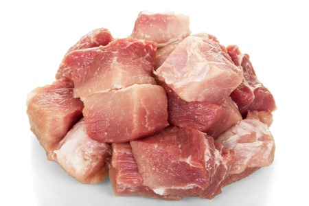 flesh eating animal: Pieces of raw pork fillet isolated on white background. Stock Photo