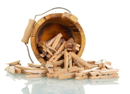 Wooden bucket with clothespins isolated on white background. Stock Photo