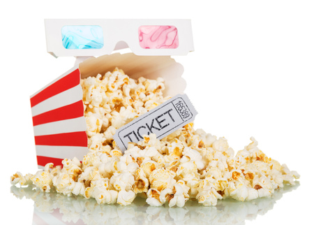 Loose popcorn in striped square box, a ticket to the cinema and 3D glasses isolated on a white background Stock Photo