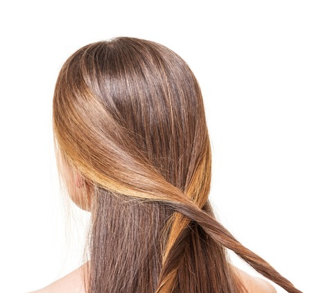 dutch girl: The girl with long brown hair braided strands of isolated on a white background.