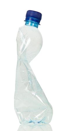 Blank crumpled plastic bottle isolated on white background.
