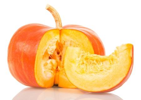 Orange pumpkin and slice isolated on white background.