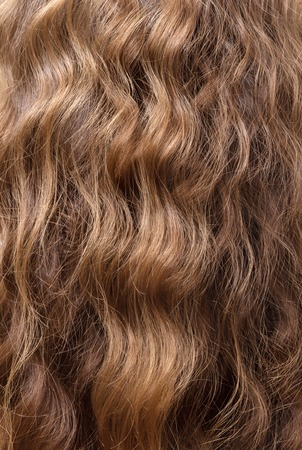 Manicured luxury shiny wavy brown hair texture.