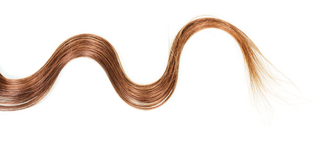 A lock wavy brown hair isolated on white background.
