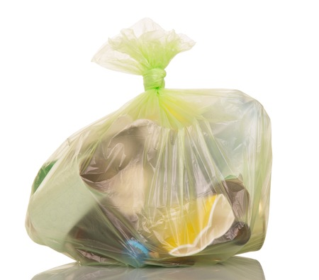 black plastic garbage bag: Garbage bags with household waste isolated on white background.