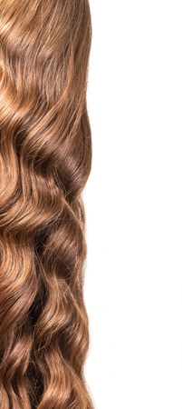 permanent wave: Shiny brown wavy hair isolated on white background.