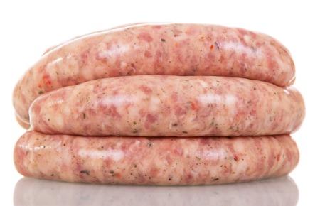 llonganissa: Raw pork sausages isolated on white background.