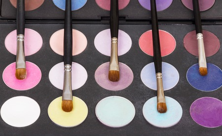 eyemakeup: Palette eye shadow and cosmetic brushes for makeup closeup. Stock Photo