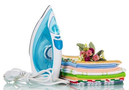 Electric iron and ironing things with a flower isolated on white background