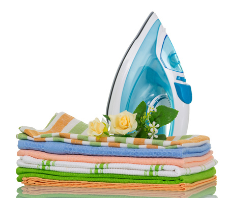 ironed: Clean ironed clothes and iron blue isolated on white background Stock Photo
