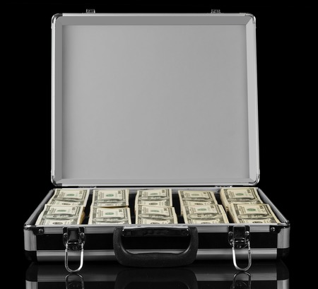 billions: Opened suitcase with dollars isolated on a black background.