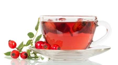 Cup of tea from rose hips isolated on a white background.