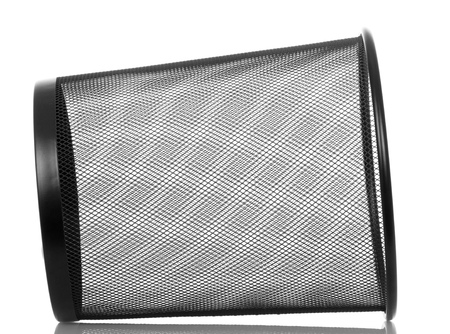 Empty metal basket for waste paper isolated on white background.