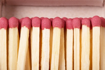 Matches against the backdrop of an open box closeup.