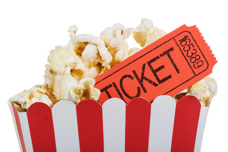 Popcorn in a big box with movie tickets, isolated on white background. Stock Photo