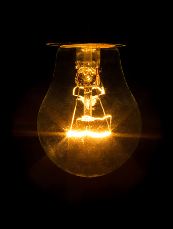 A bulb of incandescence is included isolated on a black background.