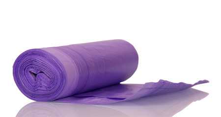 A roll of lilac polyethylene garbage bags isolated on white background. Stock Photo - 88001707