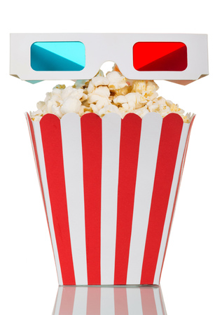 Striped box filled with popcorn and 3D glasses isolated on a white background. Stock Photo