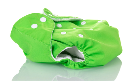 Green modern eco-friendly diaper is isolated on white background.