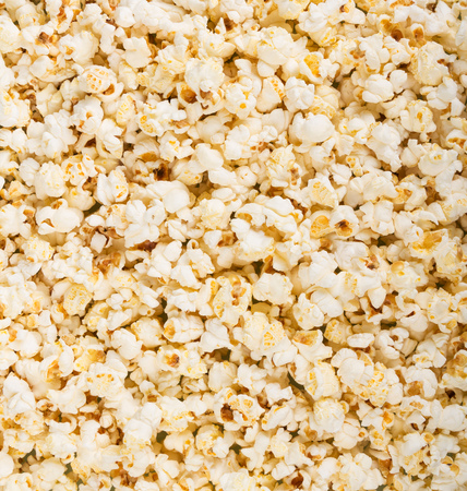 Background image of delicious fresh salty popcorn.
