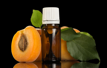 Liquid for smoking with apricot flavor isolated on black background Stock Photo