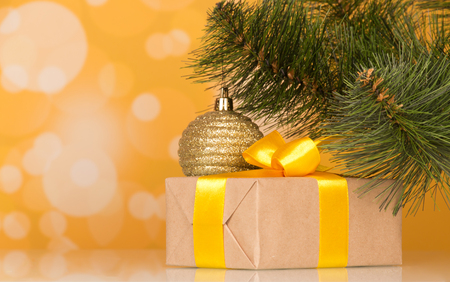 New Years accessories and gift in box on yellow sparkling background Stock Photo