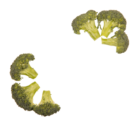 Ripe inflorescences of broccoli, laid out originally isolated on white background.