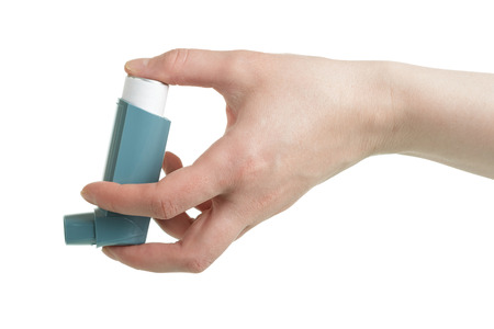 Small pocket inhaler in female hand, isolated on white background
