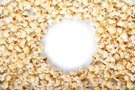 Round frame made of popcorn isolated on white background.