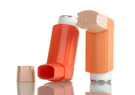 Orange asthma inhaler isolated on white background Stock Photo