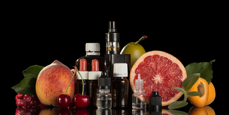 Electronic cigarette and set of different liquids for smoking isolated on black background