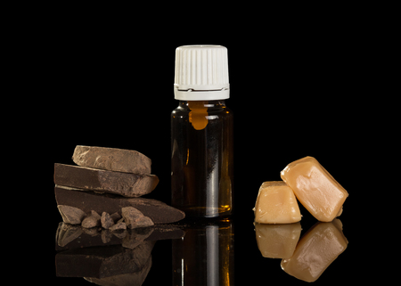 Liquid for smoking an electronic cigarette and sweets isolated on black background