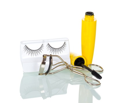 False eyelashes, mascara, and curling irons, isolated on white background Stock Photo