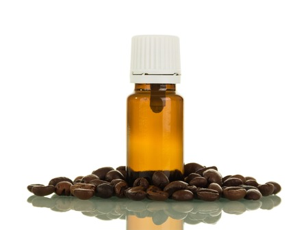 Bottle with liquid for smoking, next to scattered coffee beans, isolated on white background