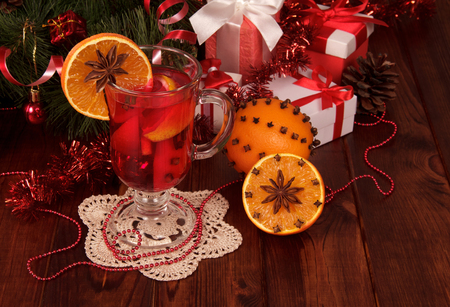 Festive warming drink and fruit boxes with gifts on wooden table Stock Photo
