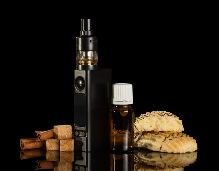 Electronic cigarette and liquid with smell of cinnamon for Smoking isolated on black background