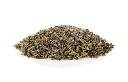 Fragrant pile of dry green tea isolated on white background